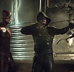 "The Flash vs. Arrow -- ""The Brave and the Bold"" -- Image AR308a_0179b -- Pictured (L-R): Grant Gustin as The Flash and Stephen Amell as The Arrow -- Photo: Cate Cameron/The CW -- © 2014 The CW Network, LLC. All Rights Reserved."
