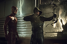 """The Flash vs. Arrow -- """"The Brave and the Bold"""" -- Image AR308a_0179b -- Pictured (L-R): Grant Gustin as The Flash and Stephen Amell as The Arrow -- Photo: Cate Cameron/The CW -- �© 2014 The CW Network, LLC. All Rights Reserved."""