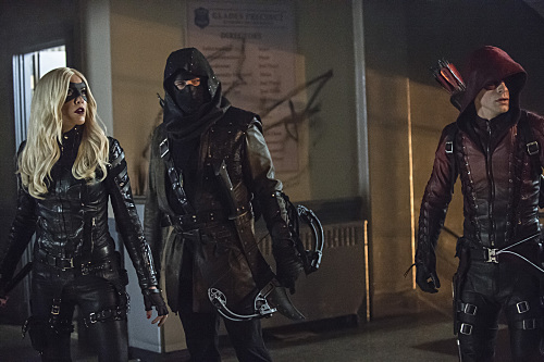 "Arrow -- ""Uprising"" -- Image AR312A_0294b -- Pictured (L-R): Katie Cassidy as Black Canary, John Barrowman as Malcolm Merlyn and Colton Haynes as Arsenal -- Photo: Cate Cameron/The CW -- �© 2015 The CW Network, LLC. All Rights Reserved."